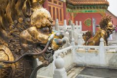 Bronze lion in front of the Hall of Supreme Harmony in Beijing F. Gilded lion statue, Forbidden City, Beijingin Beijing Forbidden City Royalty Free Stock Photos