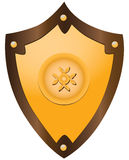 Gilded medieval shield. Gilded medieval heraldic shield shaped ornament. Vector illustration Royalty Free Stock Photography