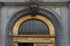 Gilded metalwork arch transom doorway Stock Photos