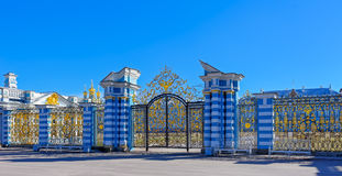 Gilded openwork gate of Catherine Palace in Tsarskoye Selo. Gilded openwork gate of Catherine Palace - the summer residence of the Russian tsars in Tsarskoye Stock Image