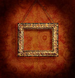 Gilded picture frame on antique wallpaper. Background Royalty Free Stock Photography