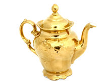 Gilded pitcher Royalty Free Stock Images