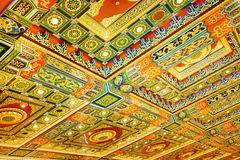 Gilded red patterns on the ceiling Stock Photo