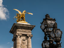 Gilded sculpture and iron lamps on Pont Alexandre III, Paris Royalty Free Stock Image