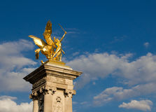 Gilded sculpture on Pont Alexandre III in Paris of Stock Images