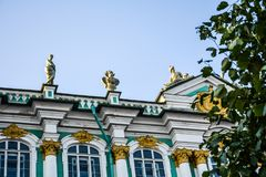 Gilded sculptures on the roof of the Hermitage, city St. Petersburg. View from the Palace Square to the walls of the Hermitage & x28;Winter Palace& x29;, St royalty free stock photo