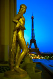 Gilded Statue at the Palais de Chaillot in Trocadero, Paris, France. The Palais de Chaillot, also named Trocadero, magnificently crowns the Chaillot hill in stock photo