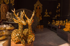 Gilded wood carving deer sculpture at Thai wooden sculpture shop Royalty Free Stock Images