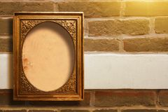 Gilded wooden frame for pictures on old brick wall stock photography