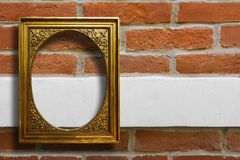 Gilded wooden frame for pictures on old brick wall royalty free stock images