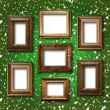 Gilded wooden frames for pictures on abstract background Royalty Free Stock Image