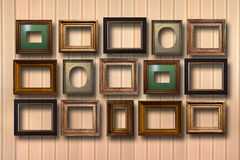 Gilded wooden frames for pictures on background Royalty Free Stock Images