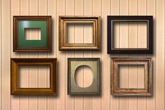 Gilded wooden frames for pictures on background Stock Photography