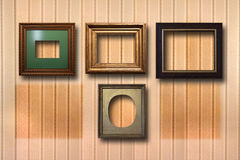 Gilded wooden frames for pictures on background Royalty Free Stock Photo