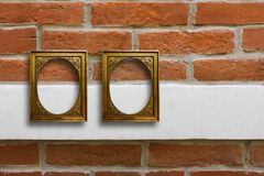 Gilded wooden frames for pictures on old brick wall royalty free stock photo