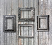 Gilded wooden frames for pictures on rusty wall Royalty Free Stock Image
