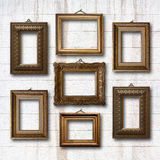 Gilded wooden frames for pictures on stone wall Royalty Free Stock Image