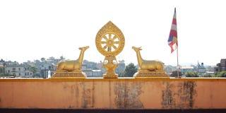 Gilding deer statues. Auspicious symbol. Buddhist temple. Gilding deer statues. Auspicious symbol. Retro filter photo. Tibetan Buddhist symbols: Dharma-wheel stock image