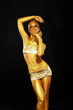 Gilding. Portrait of Sexy Woman with Shining Golden Plated Body. Expression Stock Image