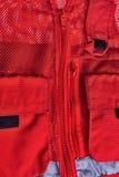 Gilet rouge de sauvetage. Image libre de droits