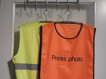 Gilets jaunes et oranges de gilet, photo de presse image libre de droits