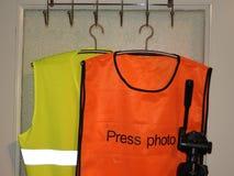 Gilets jaunes et oranges de gilet, photo de presse photographie stock libre de droits