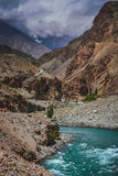 Gilgit river and road above Stock Photo