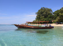 Gili Boat. A boat waits in the turquoise sea near Gili Meno, Indonesia Royalty Free Stock Image