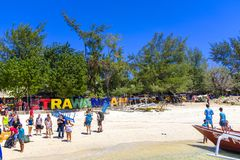 Gili Trawangan. Beach by a public harbour on Gili Trawangan, the party island, in Indonesia Stock Image