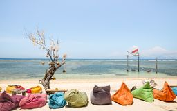 Gili Trawangan beach on a sunny day with multicolored sofas at c. Hilling lounge - Travel and vacation concept with beautiful destinations worldwide - Bali and Stock Image