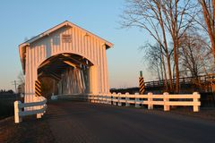 Left view of Gilkey Covered Bridge in Linn County, Oregon at sunset stock image
