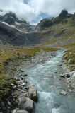 Gill in valley nearby glacier in Alps in Switzerland Stock Photos