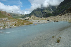 Gill in valley nearby glacier in Alps in Switzerland Royalty Free Stock Images