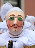 Gille wearing their traditional wax mask, Binche Carnival, Belgium Royalty Free Stock Image