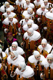 'Gille' wearing their traditional wax mask, heading to the Town Hall,  morning of Shrove Tuesday, at Binche Carnival, Town of Binc. The Carnival of Binche is an Stock Images