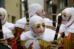 'Gille' wearing traditional wax mask, Binche, Belgium. 'Gille' wearing their traditional wax mask, heading to the Town Hall,  morning of Shrove Tuesday, at Royalty Free Stock Photography