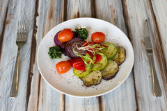 Gilled vegetables salad on wooden table Royalty Free Stock Photos