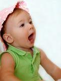 Gillend babymeisje Stock Fotografie