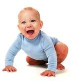 Gillende babyjongen Stock Foto