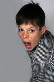 Gillende jongen Stock Foto's