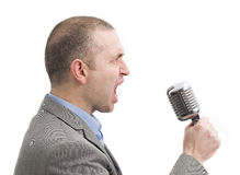 Gillende mens met een microfoon Stock Foto