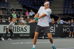 Gilles Muller (LUX). METZ, FRANCE - SEPTEMBER 25, 2015: Gilles Muller (LUX) during his match against Gilles Simon (FRA) at the Moselle Open in Metz, France, on Royalty Free Stock Photos
