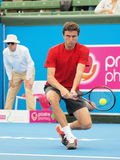 Gilles Simon of France hitting low backhand Royalty Free Stock Photography