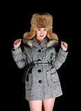 Gilr in coat and fox cap  on black background Royalty Free Stock Photography