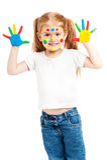 Gilr de tres años con las manos brillantemente pintadas Foto de archivo
