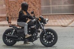Gilr riding motorbike 2 Stock Photo