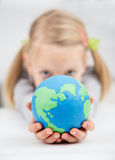 Gilrl holding the earth globe royalty free stock images