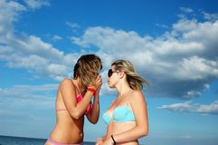 Gilrs on beach. Two girls talking to each other on the beach Stock Photos