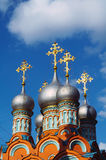 The gilt crosses on domes of orthodox church. On a background of the blue sky Stock Photography
