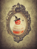 Gilt Frame With Halloween Cupcake. And spider Stock Images